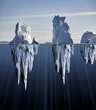 Au-dessus et au-dessous de la vue de l'eau des icebergs Images libres de droits