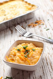 Au gratin funeral cheesy potatoes. With chives and sharp cheddar cheese Royalty Free Stock Image