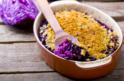 Au gratin from red cabbage. In a ceramic form for roasting. style rustic. selective focus royalty free stock photo
