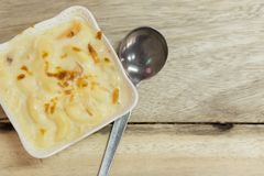 Au Gratin in white bowl on a  wooden table stock photo