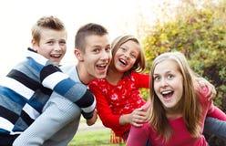 Au pair met kinderen Stock Afbeelding