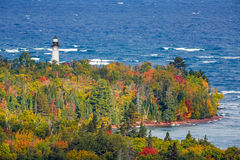 Au Sable Light in Autumn. Au Sable Light Station, a lighthouse on the Lake Superior Coast of Michigan's Upper Peninsula, is surrounded by colorful autumn foliage Stock Photos