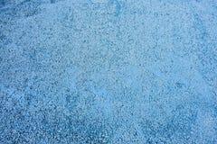 Au sol de bleu d'asphalte photo stock