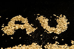 AU spelled in gold nuggets Royalty Free Stock Photo