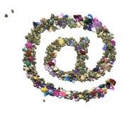 Au symbole fait à partir des roches et des gemmes brillantes d'or Photos stock