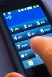 Au téléphone d'écran tactile photographie stock libre de droits