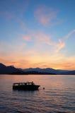Aube de lac boat Photographie stock libre de droits