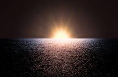 Aube en mer Image stock