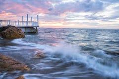 Aube par la mer Images libres de droits