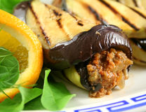 Aubergine Beef Roll. Chargrilled egg plant and beef rolls with an orange and fennel salad Stock Photos