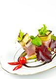 Aubergine beefs olive with Parma ham. A Aubergine beefs olive with Parma ham Royalty Free Stock Images