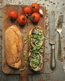 Aubergine and cheese sandwich with tomatoes on a vintage background Stock Image