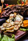 Cuisine Culinary Buffet Dinner Catering Dining Food Celebration Party Concept. Aubergine cooked on a grill, cut in long pieces and beautifully laid out on a stock photo