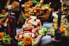 Cuisine Culinary Buffet Dinner Catering Dining Food Celebration Party Concept. Aubergine cooked on a grill, cut in long pieces and beautifully laid out on a stock image