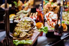 Cuisine Culinary Buffet Dinner Catering Dining Food Celebration Party Concept. Aubergine cooked on a grill, cut in long pieces and beautifully laid out on a stock photography