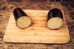 Aubergine cut in half Stock Photos