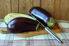 Aubergine cut in half Royalty Free Stock Images