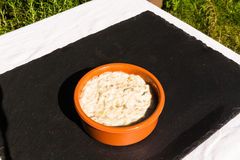 Aubergine dip in ceramic bowl outdoors on slate mat. Royalty Free Stock Images
