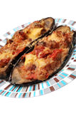 Aubergine dish. Baked aubergine stuffed with vegetables and cheese royalty free stock photography