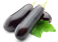 Aubergine with leaves Stock Photos