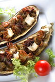 Aubergine with octopus Stock Photography