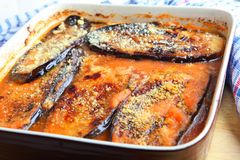 Aubergine parmigiana. Aubergines with parmesan cheese baked in a tomato pasata sauce, an Italian dish called Parmigiana di Melanzane Stock Photo