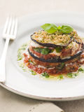 Aubergine Parmigiana Tower with Herb Oil Royalty Free Stock Photo