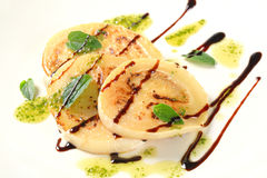 Aubergine with pesto and balsamico. Slices of pan fried aubergine with pesto and balsamic vinegar royalty free stock image