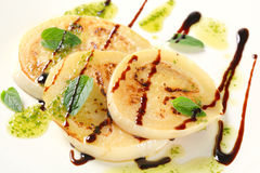 Aubergine with pesto and balsamico Stock Photos
