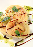 Aubergine with pesto and balsamico. Slices of pan fried aubergine with pesto and balsamic vinegar stock image
