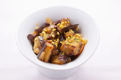 Aubergine, pistachios and chocolate. Chips stock image