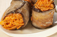 Aubergine rolls with carrot Stock Images