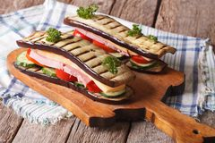 Aubergine sandwiches with vegetables, ham and cheese Royalty Free Stock Photography