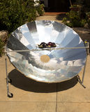 Aubergine on solar cooker Stock Photos