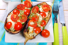 Aubergine stuffed with cherry tomato and mozzarella Stock Images