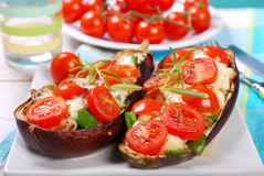 Aubergine stuffed with cherry tomato and mozzarella Royalty Free Stock Images