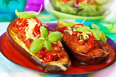 Aubergine stuffed with meat in tomato sauce Stock Photo