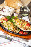 Aubergine stuffed with vegetables and cheese Royalty Free Stock Photo
