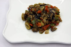 Aubergine with sweet pepper. And olive stock image