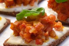 Aubergine tartar on bread Stock Photography