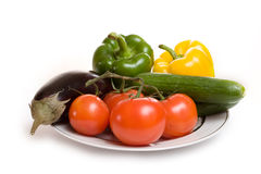 Aubergine tomato cucumber sweet pepper on plate Royalty Free Stock Images