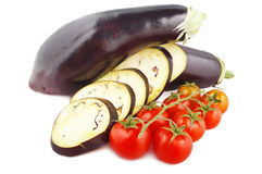 Aubergine and tomatoes Royalty Free Stock Photos
