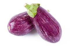 Aubergine- und Zucchinikirschtomaten stockbilder