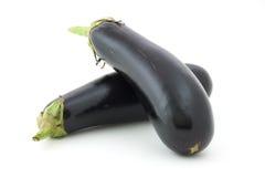 Aubergine variety. Eggplant isolated on textured white paper. Variety of aubergine Stock Image
