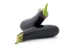 Aubergine variety. Eggplant isolated on textured white paper. Variety of aubergine Stock Photography