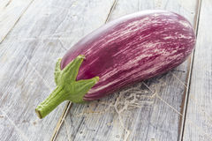 Aubergine on white table Stock Images