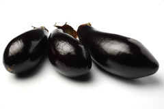 Aubergines. 3 aubergines on isolated white background Royalty Free Stock Photo