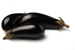 Aubergines. 3 aubergines on isolated white background Royalty Free Stock Photos