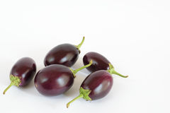 Aubergines (brinjals) on white Stock Image