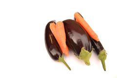 Aubergines with carrots Royalty Free Stock Image